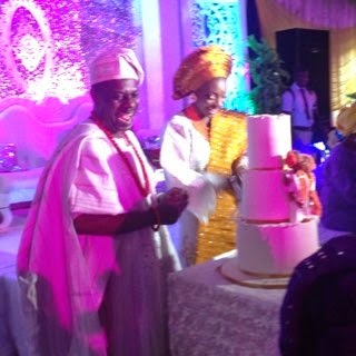 The happy couple cutting the cake Poju and Fajusigbe at their engagement party on Friday, February 6, 2015 (Photo Credit: Linda Ikeji)