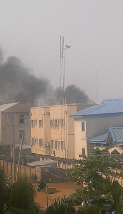 Smoke seen rising from the scene pf the bomb blast in kano