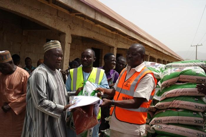 Abuja Co-ordinator of NEMA, Chonoko distributes relief material at the IDP camp in Abuja (Photo Credit: PR Nigeria)