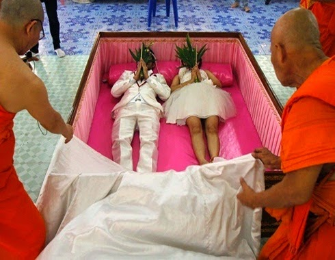 Couples weds inside a coffin on Saturday, February 14, 2015 in Thailand  (Photo Credit:  Bangkok Post)