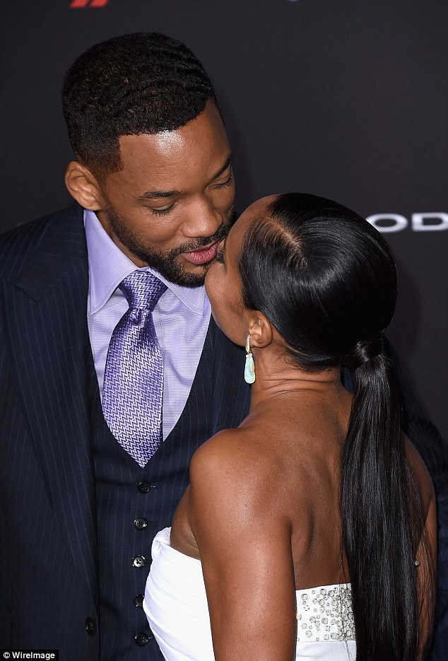 A couple that kiss together, stay together. Will Smith and Jada Smith at the Los Angeles premiere for his new film Focus on Tuesday, February 24, 2015 (Photo Credit: Mail Online)