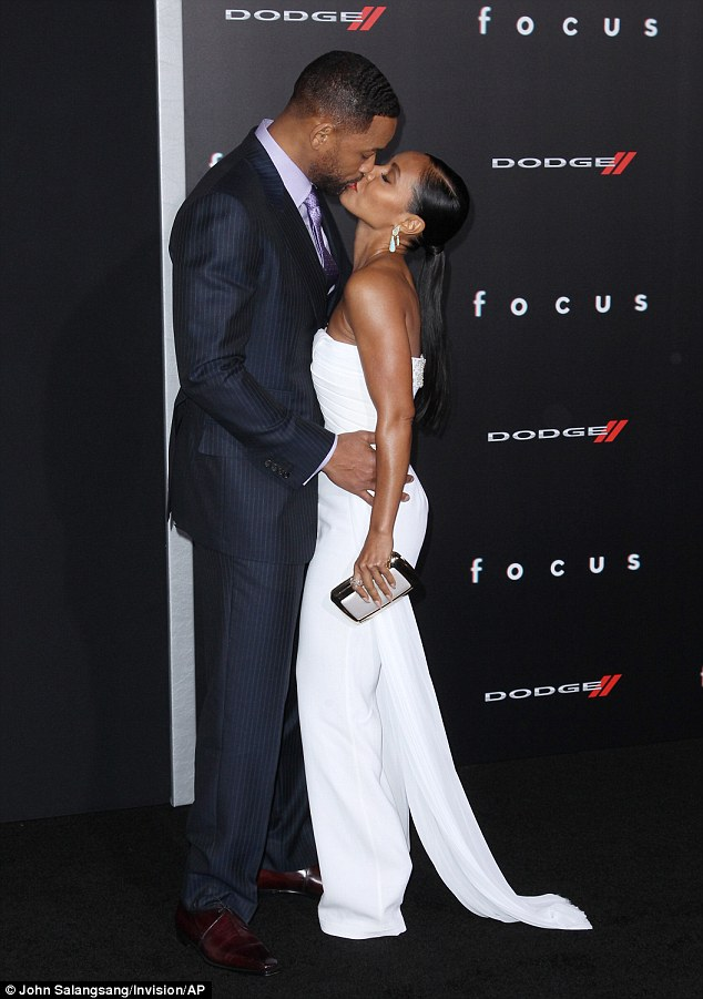 Will Smith and Jada Smith heavy PDA moment at the Los Angeles premiere for his new film Focus on Tuesday, February 24, 2015 (Photo Credit: Mail Online)