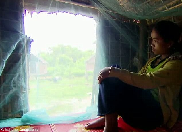 A teenage girl inside her Love hut while waiting for her lover in Cambodia (Photo Credit: Weird News)