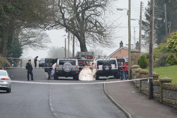 Horrified guests outside St Mary's Church in Newtownbutler, Co Fermanagh after a gunman opened fire on guests on Wednesday, February 11, 2015 killing one man and injuring two others. (Photo Credit: Ronan McGrade/ Fermanagh Herald)
