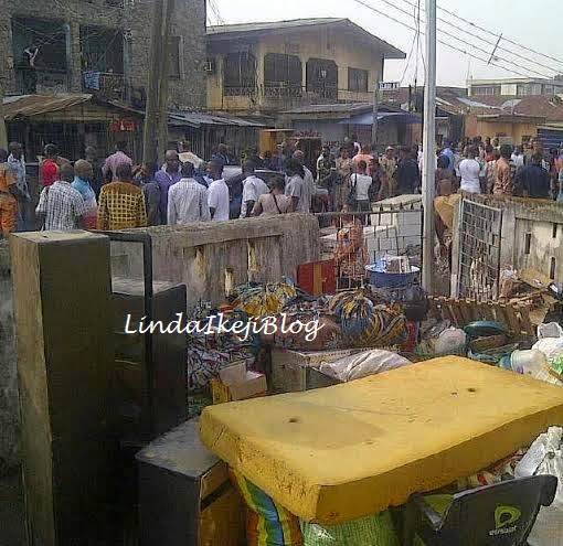 Occupants of number 3, Ladele Dada Street in Surulere Lagos thrown out of their homes by new owner on Monday, March 2, 2015 (Photo Credit: Linda Ikeji)