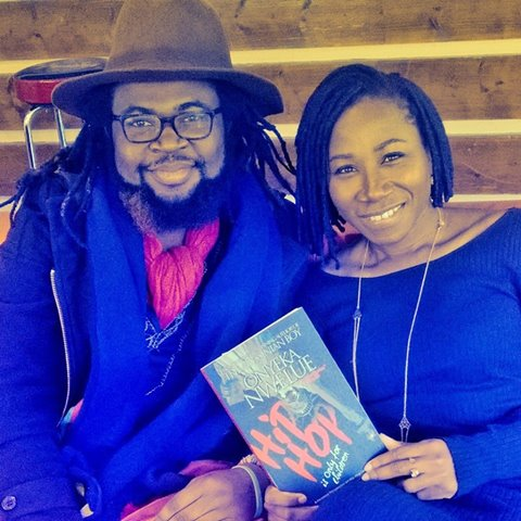 The author, Onyeka Nwelue and singer Asa pose with a copy of the book, Hip Hop is Only for Children in Paris, France