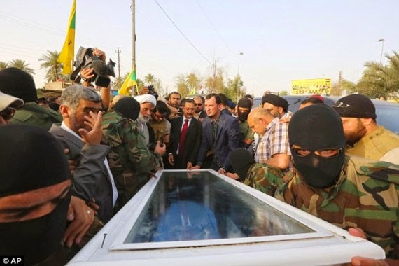 The remains of Izzat Ibrahim al-Douri, one of the Iraqi generals and a commander of the Army of the Men of the Naqshbandi Order, was on Monday, April 20, 2015 paraded in a glass coffin for the entire citizenry to see that he has been killed. (Photo Credit: Reuters)