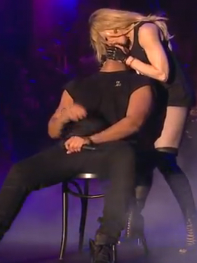 Singer Madonna kisses Drake on stage at the end of a stage performance on Sunday, April 12, 2015 at the Coachella Valley Music and Arts Festival in Indio, Calif. (Photo Credit:Youtube)