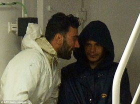 What guts: Malek smiles alongside his alleged smuggler accomplice, a 26-year-old Syrian crew member named Mahmud Bikhit, who was also arrested and charged with 'favouring illegal immigration'. (Photo Credit: Reuters)