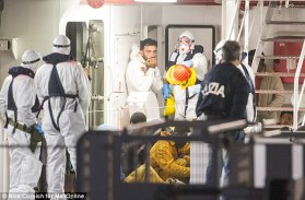 Nervous: Tunisian boat captain Mohammed Ali Malek (centre) bites his nails as he waits to disembark an Italian coastguard ship before being arrested over the deaths of 950 migrants who died when his ship sank. (Photo Credit: Nick Cornish for Mail Online)