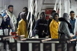Some of the survivors of the tragic boat accident pictured with the killer captain, Mohammed Ali Malek as he stared in space while waiting to leave the rescue vessel. (Photo Credit: AFP/ Getty Images)