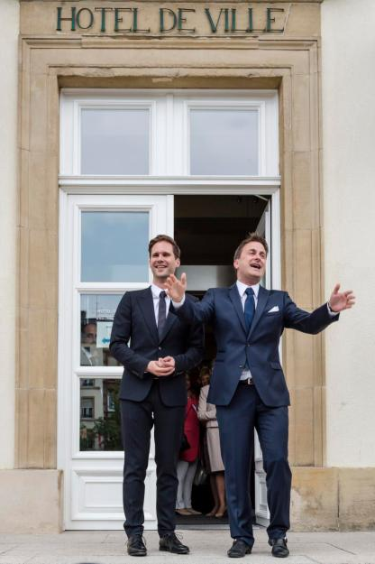 Luxembourg's Prime Minister Xavier Bettel, right, walks out of the town hall with his partner Gauthier Destenay after their marriage in Luxembourg, on Friday, May 15, 2015. The marriage comes one year after the parliament approved legislation to turn Luxembourg into an increasing number of countries allowing for same-sex marriages. Bettel and Destenay have been civil partners since 2010. (AP Photo/Geert Vanden Wijngaert)
