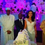 Couple cutting the cake with Gen. Muhammadu Buhari