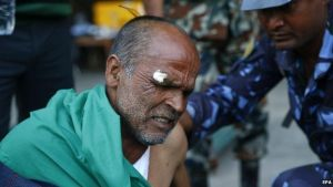 An injured man is treated at Kathmandu airport