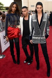 Jourdan Dunn, Olivier Rousteing and Kendall Jenner (Credit: Invicion/AP)