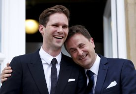 Luxembourg's Prime Minister Xavier Bettel poses with his partner, Belgian Gauthier Destenay (L), after their wedding ceremony at Luxembourg's city hall, May 15, 2015. (Photo Credit: Reuters/Francois Lenoir)