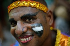 "A patient in costume from the Nise de Silveira mental health institute waits for the start of the institute's carnival parade, coined in Portuguese: ""Loucura Suburbana,"" or Suburban Madness, in Rio de Janeiro, Brazil, Thursday, Feb. 12, 2015. Patients, their relatives and workers from the institute held their parade one day before the official start of Carnival. (AP Photo/Silvia Izquierdo)"