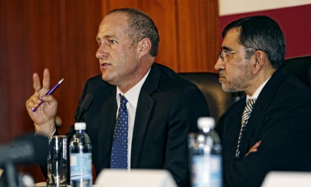 Prof Van der Merwe (L) and Prof Rafique Moosa at a press conference in March, 2015 where they announced the successful penis transplant. (Photo Credit: AFP/Getty Images)