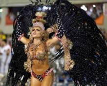 A reveller from the Salgueirol samba school participates in the annual carnival parade in Rio de Janeiro's Sambadrome, February 16, 2015. REUTERS/Pilar Olivares (BRAZIL - Tags: ENTERTAINMENT SOCIETY)