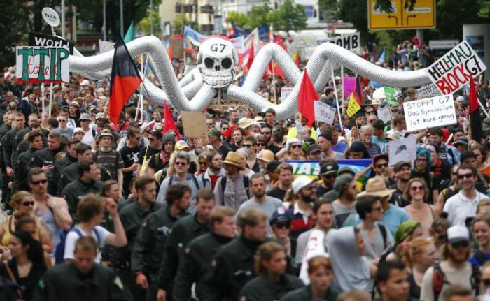 Demonstrators march down a street in Garmisch-Partenkirchen, Germany, in advance of the Group of 7's two-day summit, where world leaders will discuss climate change, free trade, terrorism and women's rights, among a host of other economic and social issues. (Photo Credit:Reuters/Hannibal Hanschke)