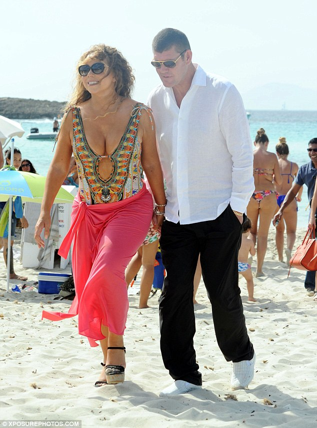 Glamour girl: The Glitter star later navigated the sand while wearing her black-strapped platform shoes