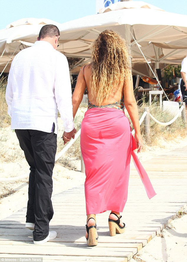 Solid ground: The wooden path that led to the restaurant made for easier walking for Mariah in those heels