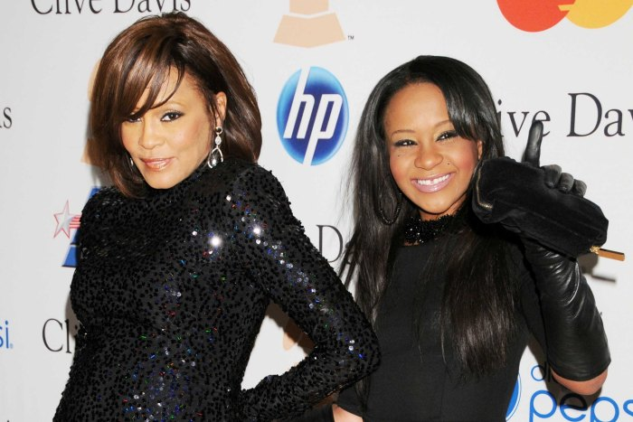 Whitney Houston and Bobbi Kristina Brown arrive at Clive Davis' pre-Grammy party honouring David Geffen in Beverly Hills, February 2011 (Photo Credit: Gregg DeGuire)