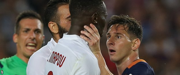 I Will Strangle You: Messi goes for Mbiwa's throat. (Photo Credit: BBC)