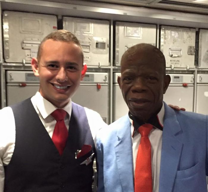 Michael Ray Huerta and the inspiring Nigerian passenger (Photo Credit: Facebook)