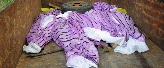 The bodies of women, who have been accused of practicing witchcraft, are placed in a truck in Kinjia village in Jharkhand state, India, Saturday, Aug. 8, 2015. (Photo Credit: AP)
