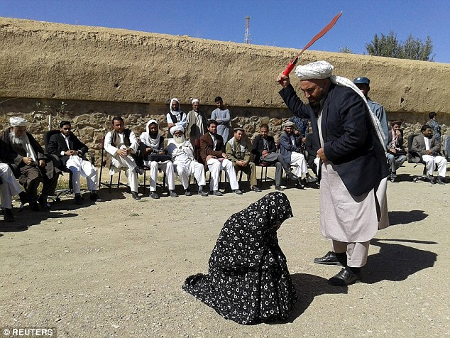 Marred woman being flogged 100 strokes publicly as punishment for committing adultery. (Photo Credit: Reuters)