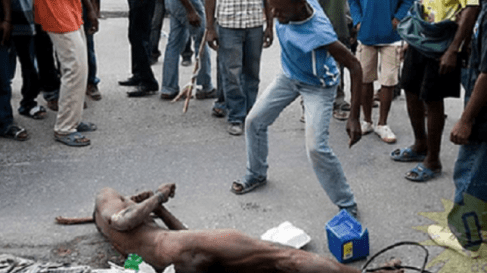 Alleged thief stripped naked and beaten to pulp in the Ikeja area of Lagos State.