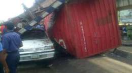 Scene of the accident on Wednesday, September 2, 2015 where a trailer slipped down the bridge and fell atop of an SUV and a Sedan vehicle at the Ojuelegba axis of Lagos State.