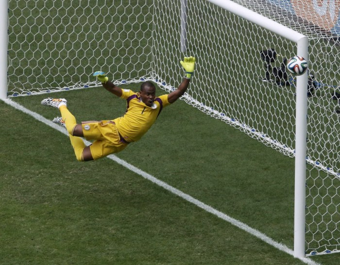 Nigeria's goalkeeper Vincent Enyeama jumps to make a save on a shot at goal by France's Paul Pogba (unseen) during their 2014 World Cup round of 16 game at the Brasilia national stadium in Brasilia June 30, 2014. | Reuters/David Gray