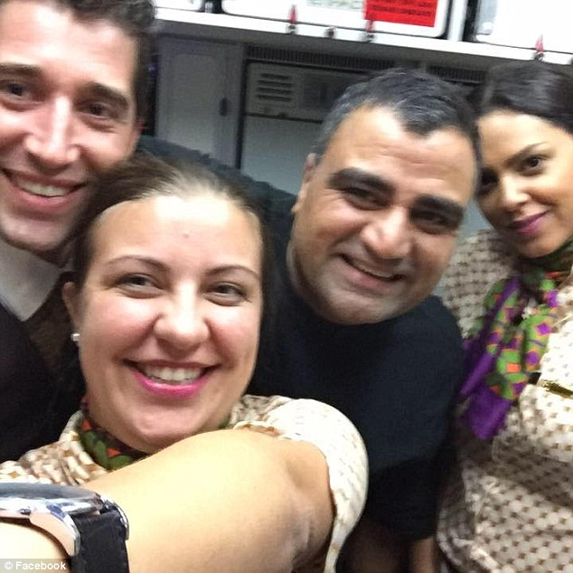 Nadeem Quraishi is pictured in the above photo with flight attendants (Photo Credit: First To Know)