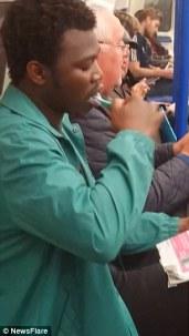 Man caught furiously brushing his teeth inside train on Monday, November 4, 2015.