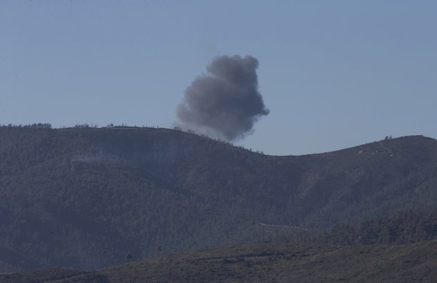 Smoke rises after a warplane crashed in Syria's northwestern Turkmen town of Bayirbucak near Turkeys border on November 24, 2015. It remains unclear to which country the aircraft belongs to. | Fatih Akta/Anadolu Agency/Getty Images