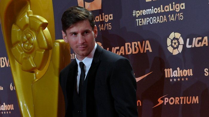 Barcelona's Argentinian forward Lionel Messi poses before the LFP 2014-2015 season award ceremony in Barcelona on November 30, 2015 | LLUIS GENE/AFP/Getty Images