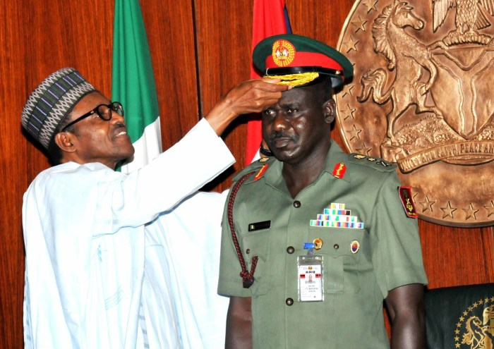 President Muhammadu Buhari (l) decorating the chief of Army staff, Major General Tukur Buratai with his new rank of Lieutenant General in the Presidential Villa, Aso Rock on Thursday, August 13, 2015 | NAN