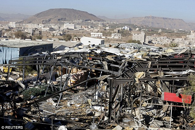 Saudi jets have 'deliberately' hit the Iranian embassy in Yemen in an air raid that wounded staff, Tehran has claimed today. Pictured: bomb damage in the capital Sanaa on December 30 | Reuters