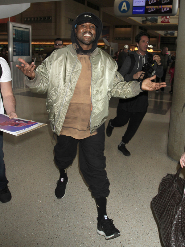 Kanye West is all smiles with arms wide open as he catches a flight out of Los Angeles. The iconic rapper was seen at LAX making his way out of town the day after the 2016 Golden Globe awards. Pictured: Kanye West Ref: SPL1207271 110116 Picture by: Sharky / Splash News Splash News and Pictures Los Angeles: 310-821-2666 New York: 212-619-2666 London: 870-934-2666 photodesk@splashnews.com