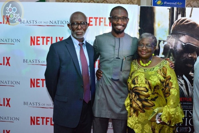 Uzodinma Iweala (middle)flanked by his parents, Dr. Iweala and Dr. Ngozi Okonjo-Iweala at Netflix' Beast of no Nation premiered on Saturday 12th December 2015 at the Silverbird Galleria in Victoria Island Lagos. | 360nobs