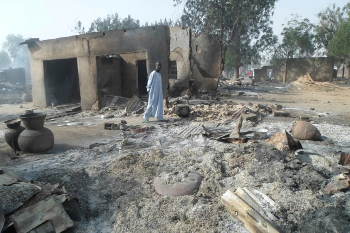 A man walks past burnt out houses following an attack by Boko Haram in Dalori village 5 kilometers (3 miles) from Maiduguri, Nigeria, Sunday Jan. 31, 2016. | AP/Jossy Ola