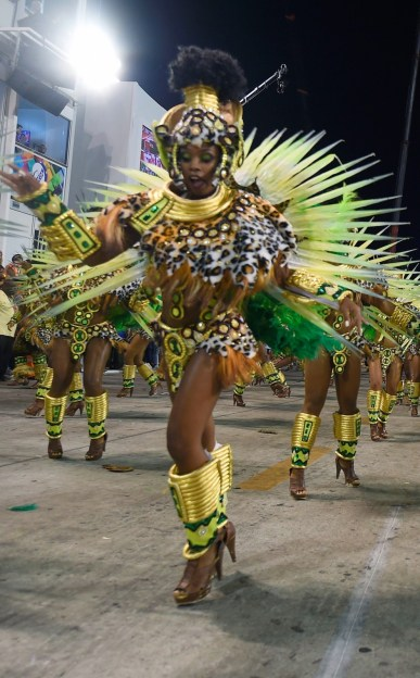 Revelers of Mocidade de Padre Miguel samba school perform during the first night of the carnival parade at Sambadrome in Rio de Janeiro, Brazil on February 8, 2016. AFP PHOTO/ VANDERLEI ALMEIDAVANDERLEI ALMEIDA/AFP/Getty Images