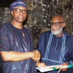Remigius Akinbinu Gov. Olusegun Mimiko of Ondo State (L) handing over to the Governor-Elect, Mr Rotimi Akeredolu