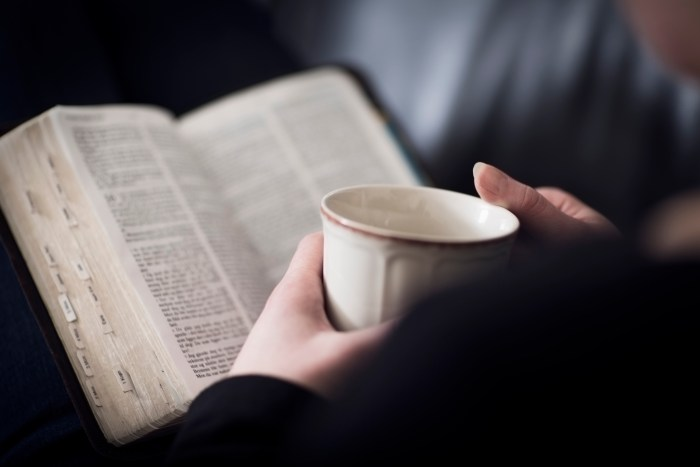 Woman Read the Bible and Drink Tea or Coffee