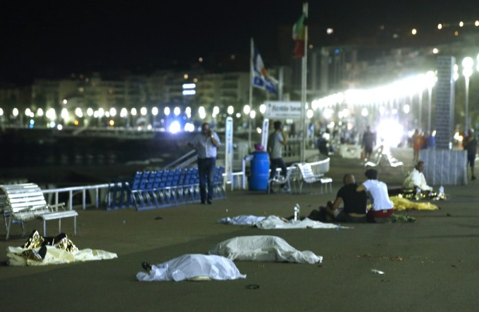 Pictured: Bodies are seen on the ground July 15, 2016 after at least 30 people were killed in Nice, France, when a truck ran into a crowd celebrating the Bastille Day national holiday, July 14, 2016. | Reuters