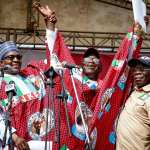 President Buhari with Ekiti state APC Gubernatorial candidate Dr John Kayode Fayemi and APC National Chairman Adams Oshiomhole as he attends the Grand Finale of the APC Gubernatorial Campaign Rally in Ekiti State on 10th July 2018