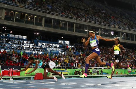 Down and not out: the Bahamas' Shaunae Miller, left, beats United States' Allyson Felix, right, to win the women's 400m final. | Martin Meissner/AP