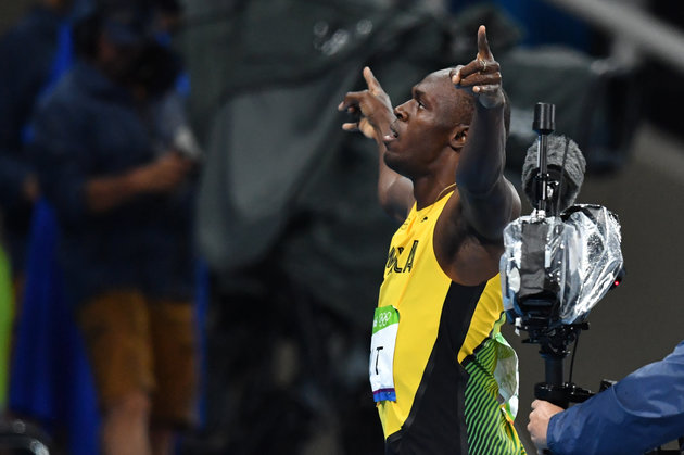 Jamaica's Usain Bolt celebrates after winning the Men's 200m Final during the athletics event at the Rio 2016 Olympic Games at the Olympic Stadium in Rio de Janeiro on August 18, 2016. | Yuri Cortez/AFP/Getty Images